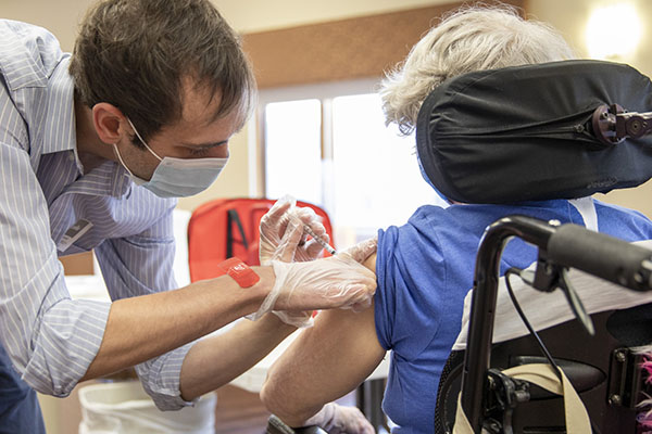 Pharmacist Danny Snyder vaccinates a Dunklau Gardens resident