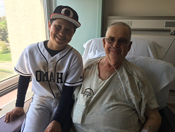Delrae Eaton shown with his grandson in his baseball uniform
