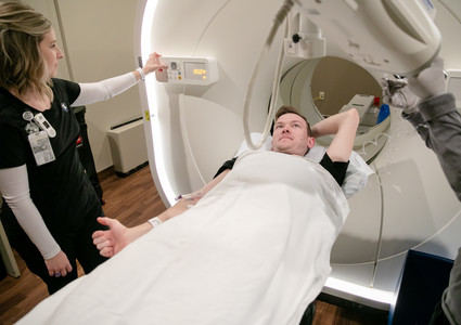 Jake Arnold is prepared for a digital PET scan at Methodist Hospital.