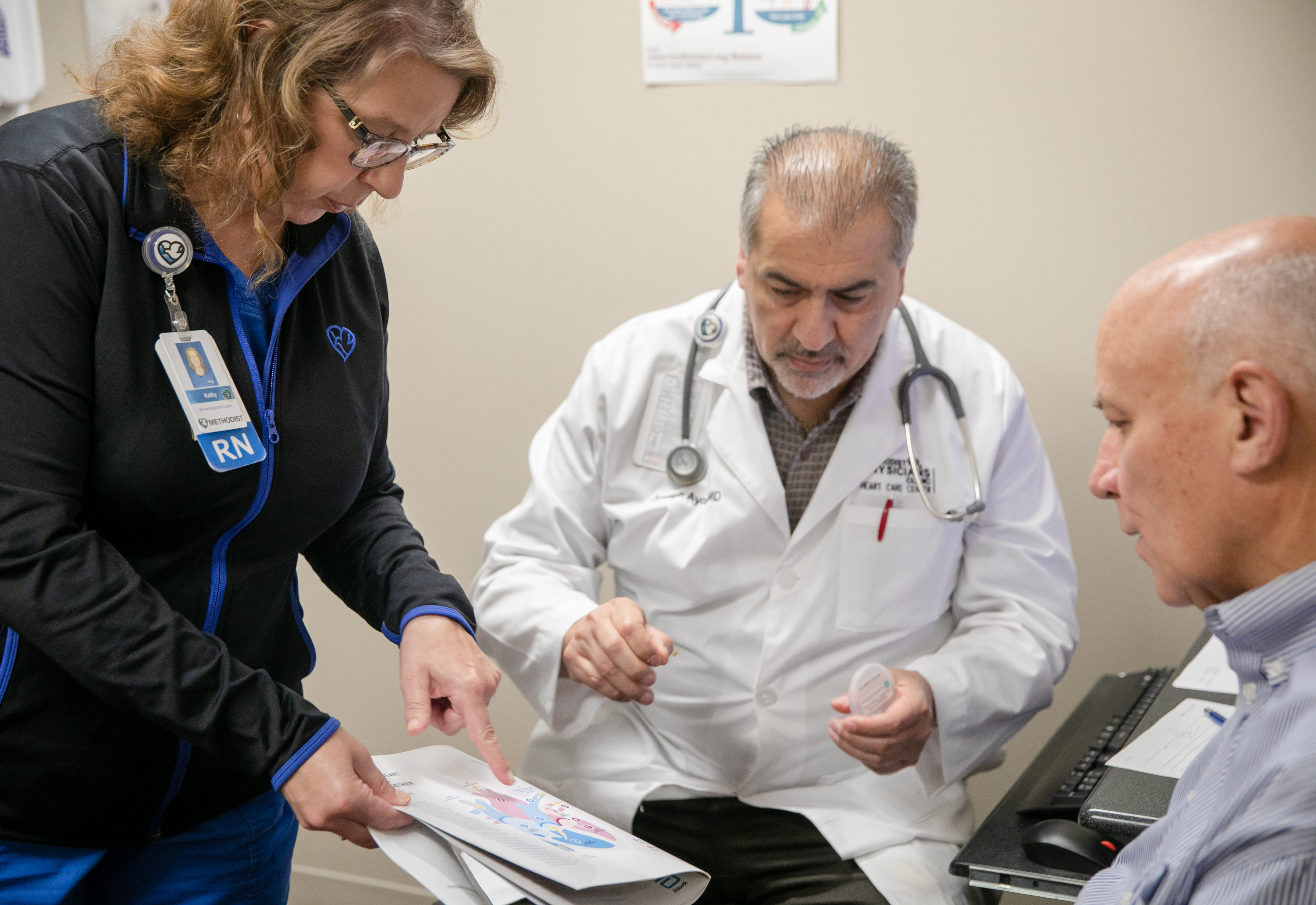 Kathy Sindelar, BSN, RN, and Joseph Ayoub, MD, meet with Tom Lowndes at a cardiology appointment