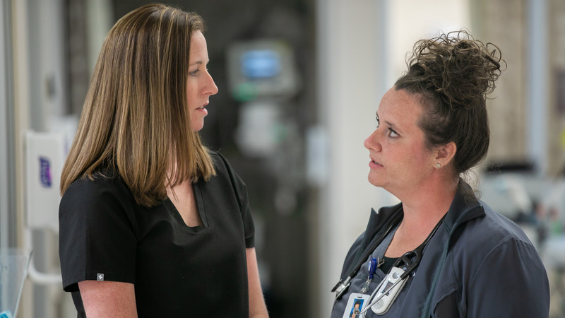 Laura Millemon, MD, a physician in the Methodist Hospital Emergency Department, consults with geriatric resource nurse Jessica Lock