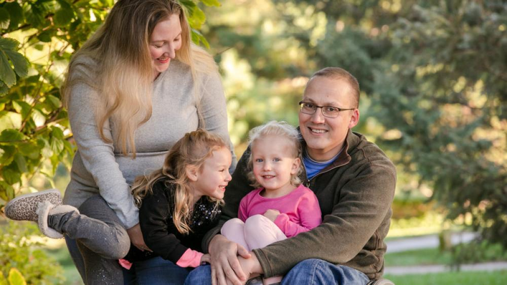 Mike Lambert with his wife and daughters